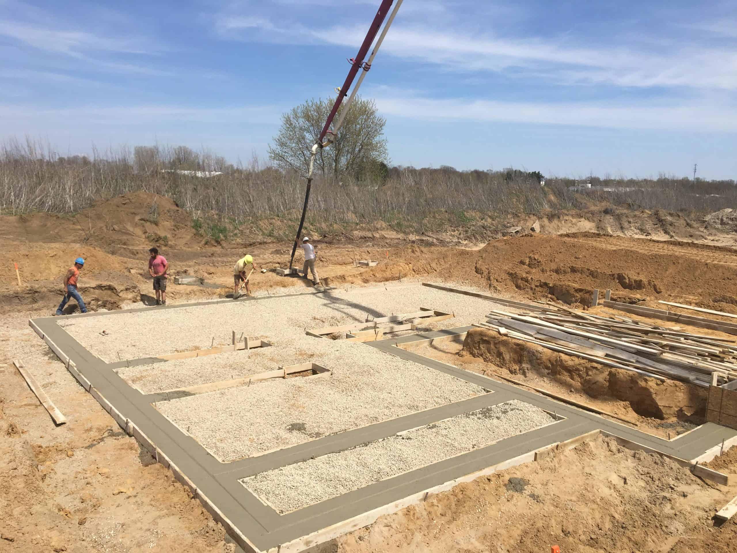 Concrete Form Setters building house foundation